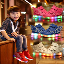 Children's boys with lighted girls shine shoes