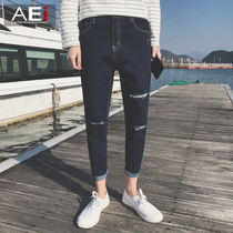 Embroidered hole in the Korean version of the trend of slim young nine minutes of pants