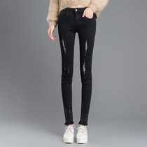 Students hole in the Korean version of the slim waist black Flash foot pants