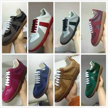 靴はMMM実行しているヨーロッパやアメリカのファッション野生のシンプルなレザー混合色カジュアルスポーツシューズのメンズ日常の流入